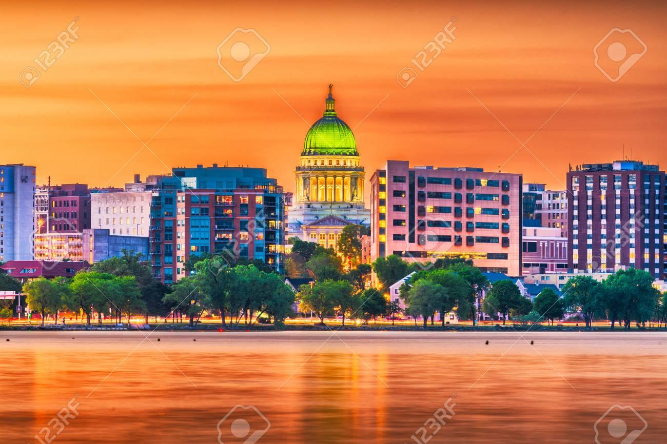 Madison, Wisconsin, USA downtown skyline at dusk on Lake Monona. - 104755820