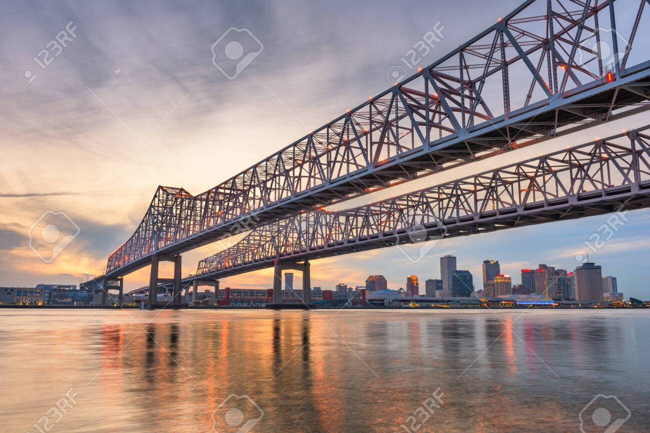 New Orleans, Louisiana, USA at Crescent City Connection Bridge over the Mississippi River at dusk. - 133611103