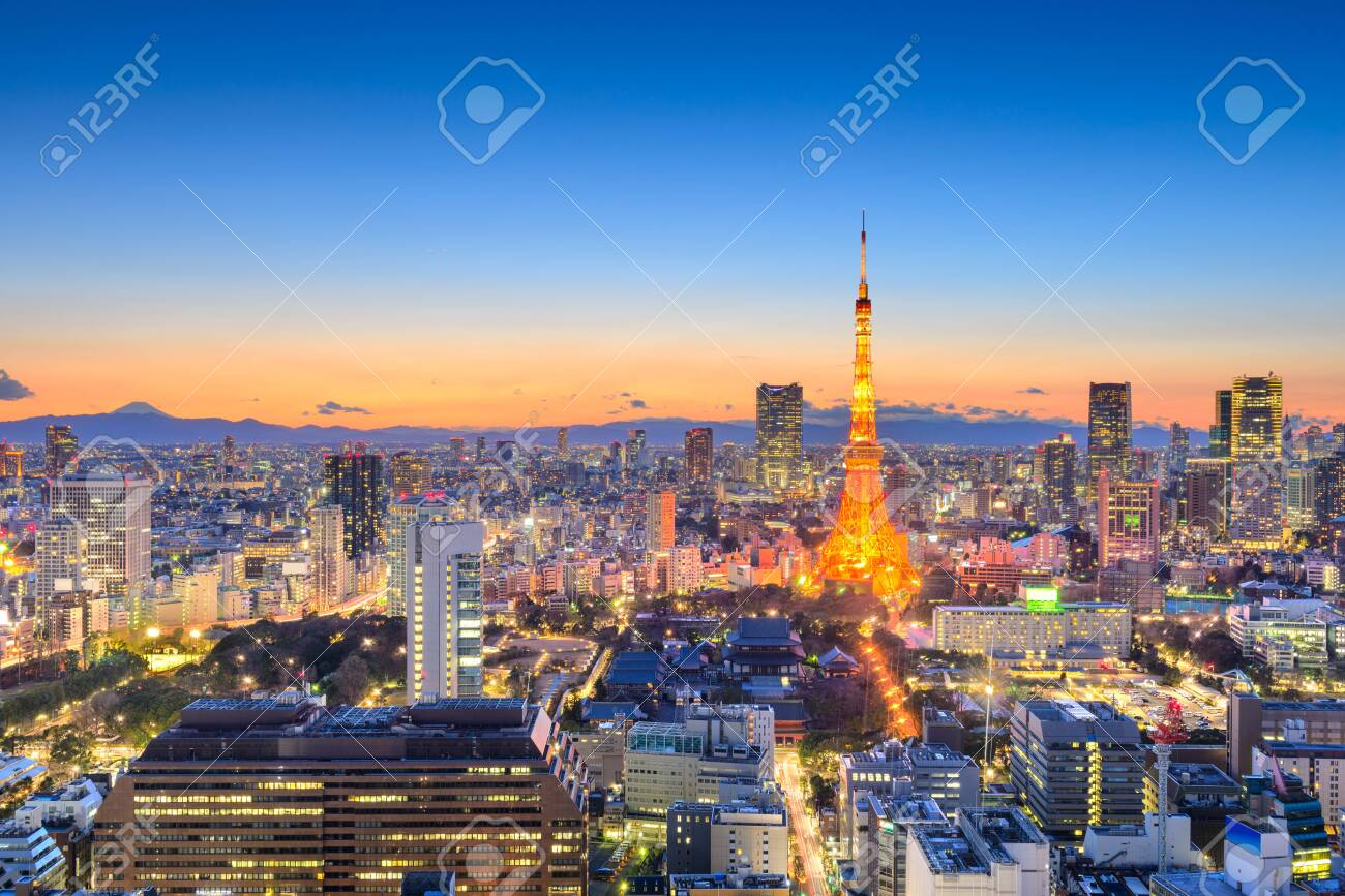 Tokyo, Japan downtown cityscape in the Minato Ward at dusk with the tower and Mt. Fuji in the distance on the horizon. - 133787050