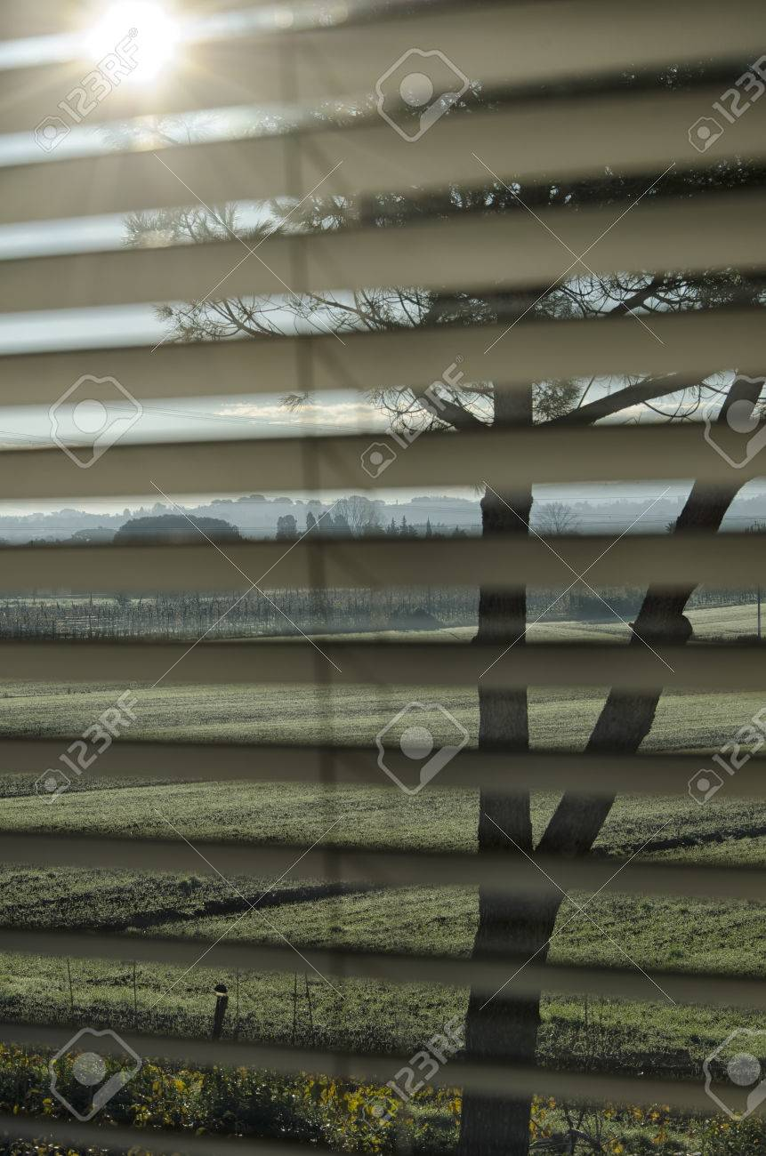 persian blinds which lets pass the sunbeam stock photo picture and