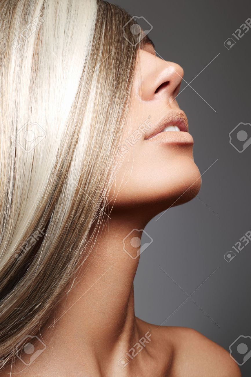 Beautiful woman with long blond hair on gray background Stock Photo - 7754715