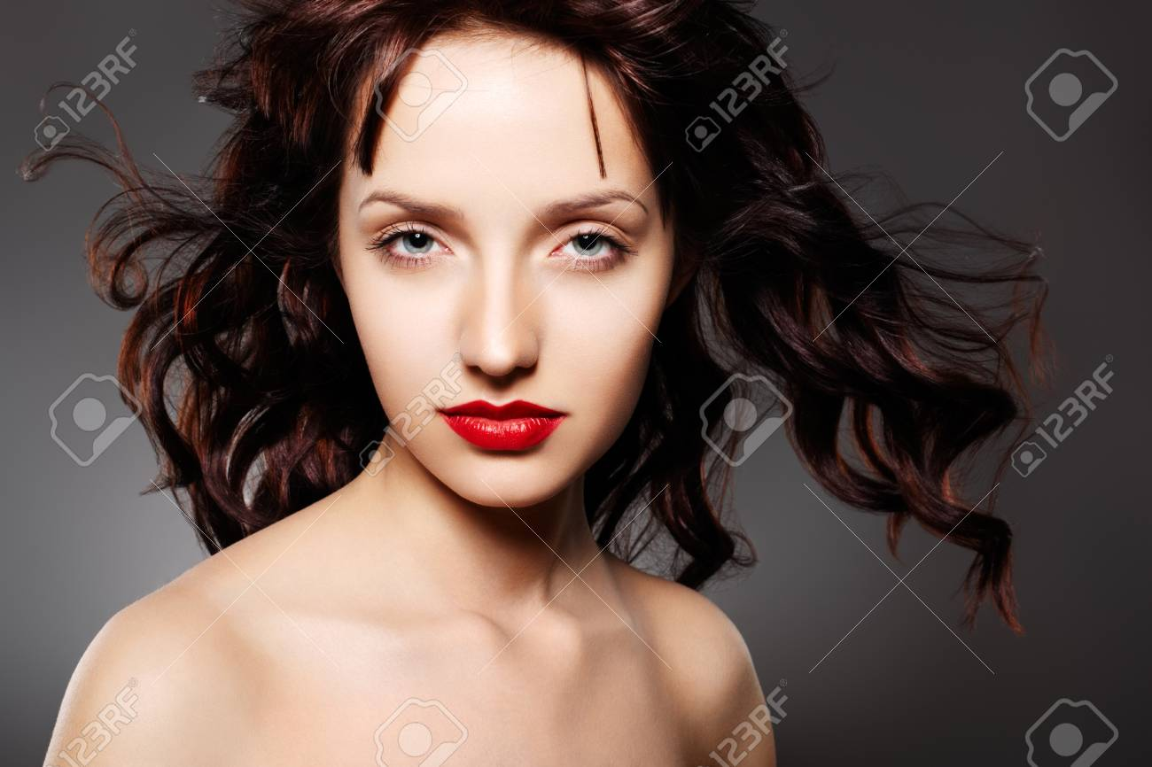 Luxury woman with juicy red lips on gray background Stock Photo - 8647162
