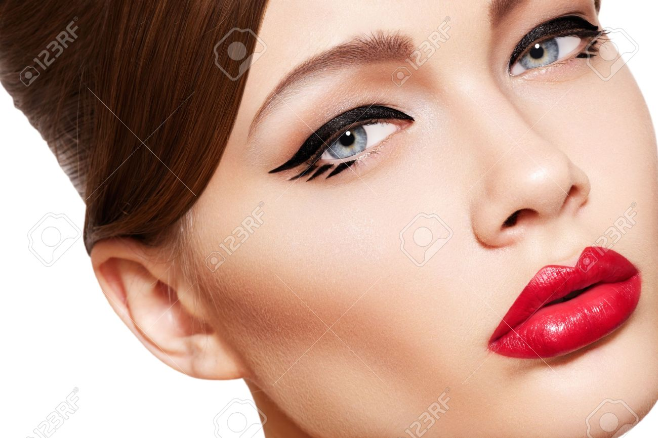 Close-up portrait of sexy caucasian young woman model with glamour red lips make-up, eye arrow makeup, purity complexion. Perfect clean skin. Retro beauty style Stock Photo - 11714190
