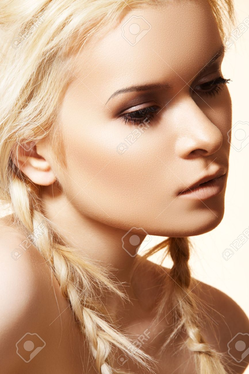 Beautiful Blond Woman With Fashion Hairstyle With Braids Hippie