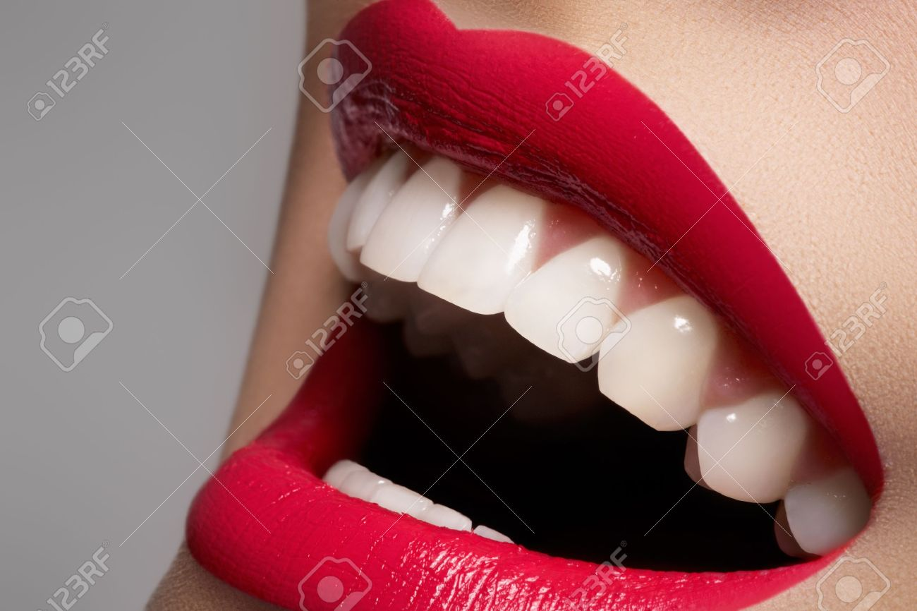 Close-up happy female smile with healthy white teeth, bright magenta lips make-up. Cosmetology, dentistry and beauty care. Macro of woman's smiling mouth - 11713907