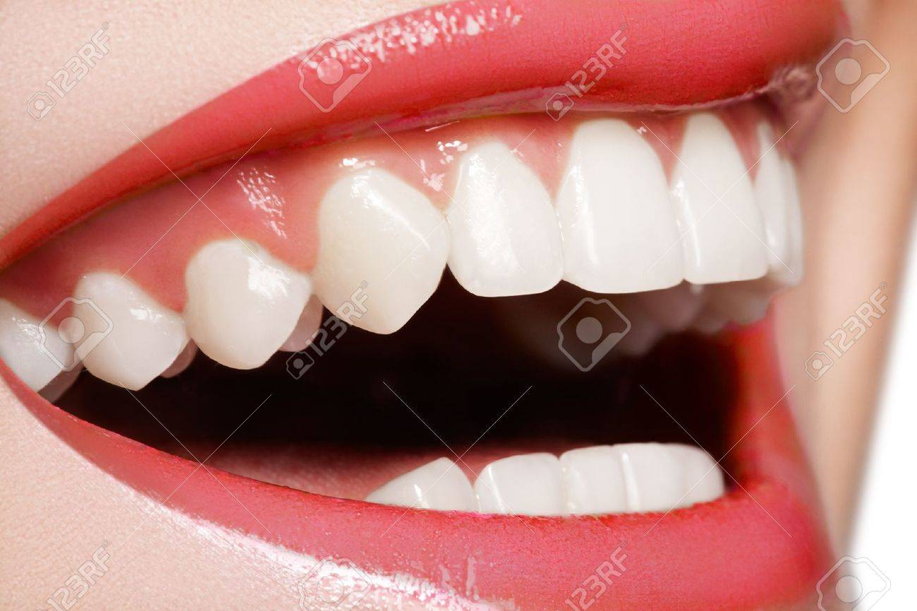 Macro happy woman's smile with healthy white teeth, bright red gloss lips make-up. Stomatology and beauty care - 11713883