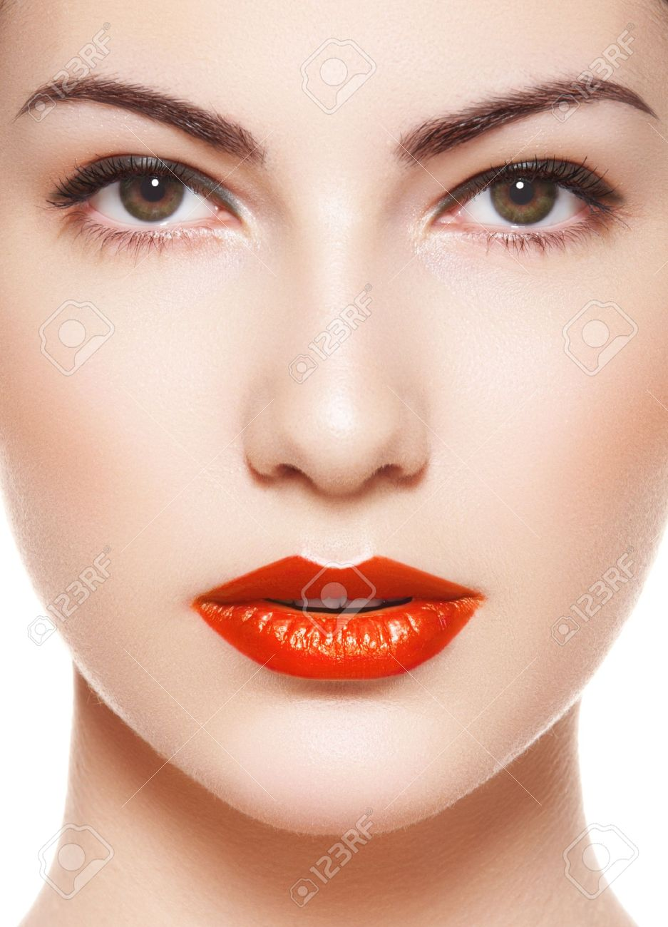 Cute model face with bright evening make-up, orange lipstick, purity skin on white background Stock Photo - 11572483