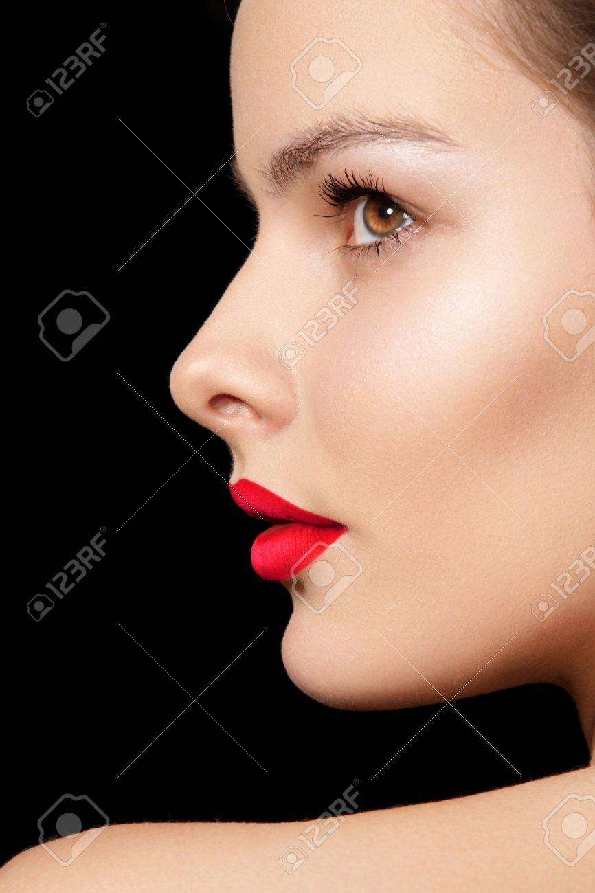 close up side view of beauty with clean skin bright make up