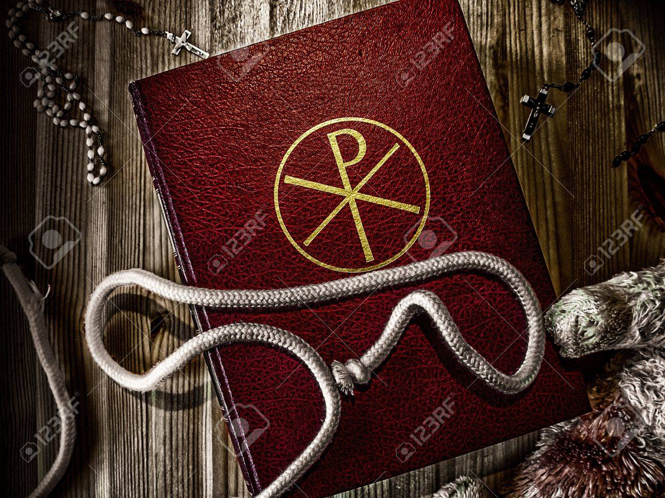 Bible with rosary and Teddy Stock Photo - 17334622