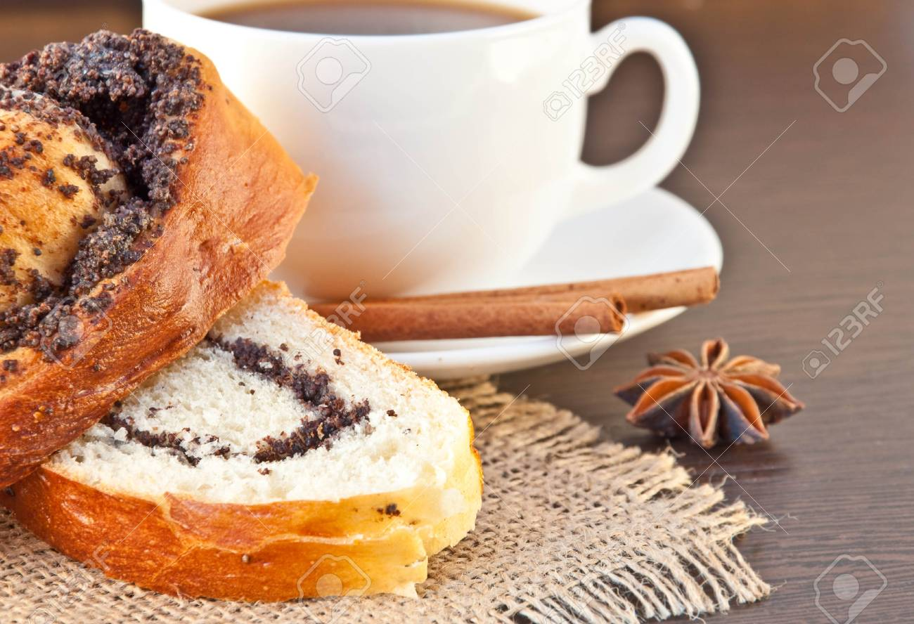 Cup of coffee and appetizing cake on a wood background Stock Photo - 10689454