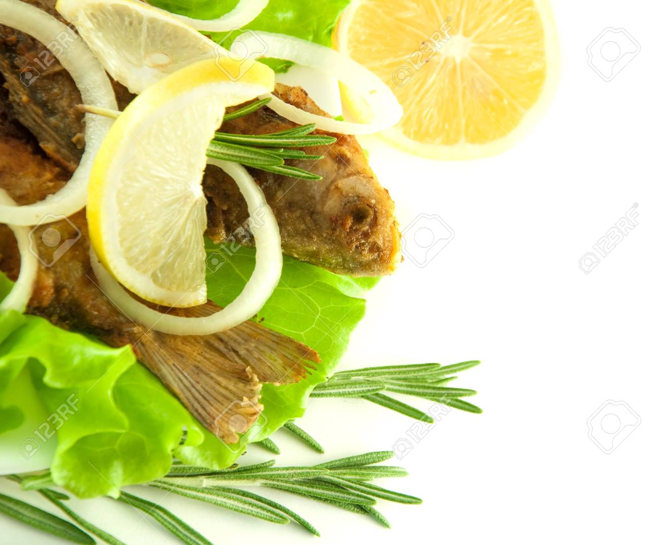 Fish fried, a crucian with a lemon, rosemary and olive oil Stock Photo - 11377044