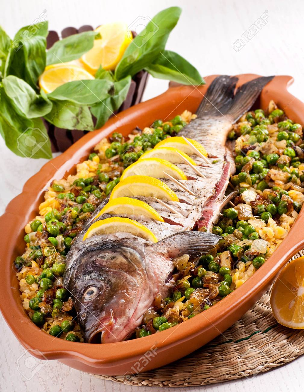 Baked crucian on a pillow from lentil and peas Stock Photo - 19244001