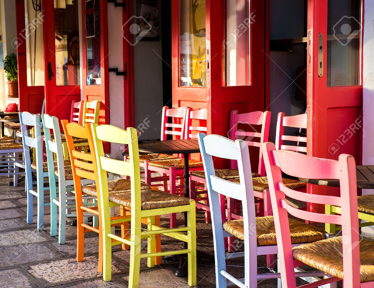 Merveilleux Greek Island Restaurants With Colorful Tables And Chairs. Stock Photo    35681759