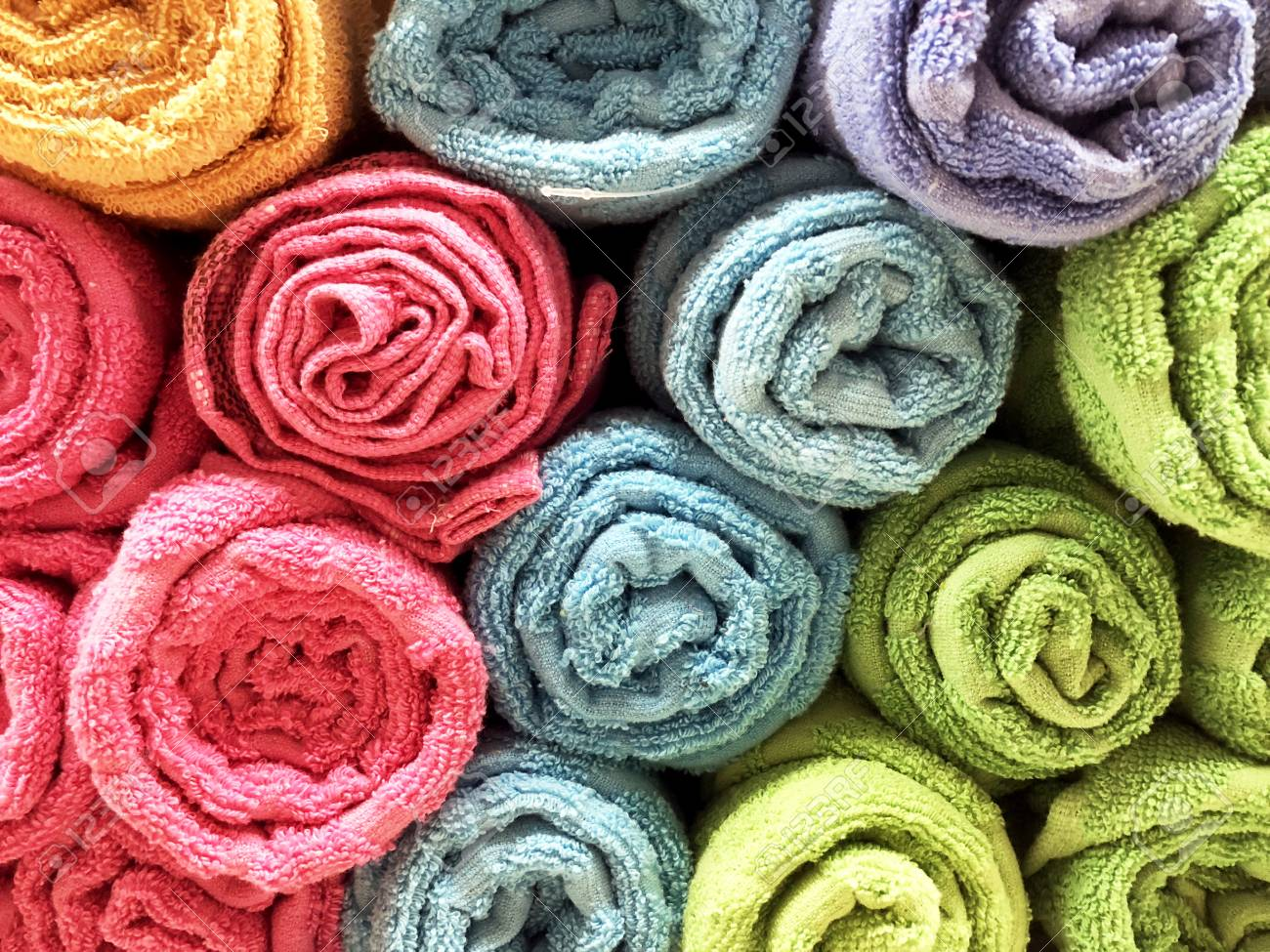 Multi-colored Towels Rolled Into A Tube Lie On Each Other On.. Stock ...