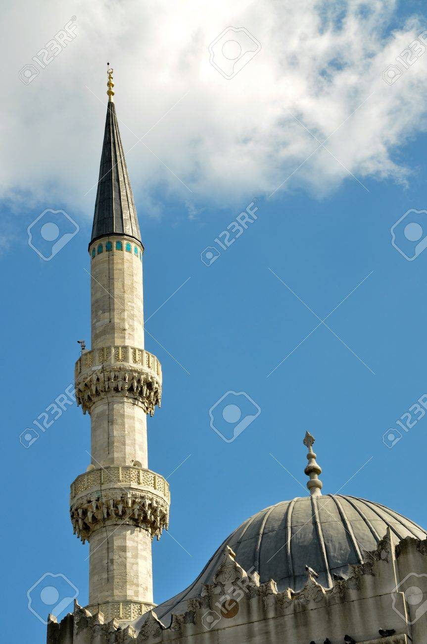 Minaret of the mosque and the sky Stock Photo - 13791385