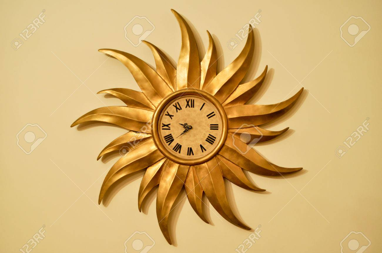 Decorative Wall Clock In The Form Of Golden Sun Stock Photo, Picture ...