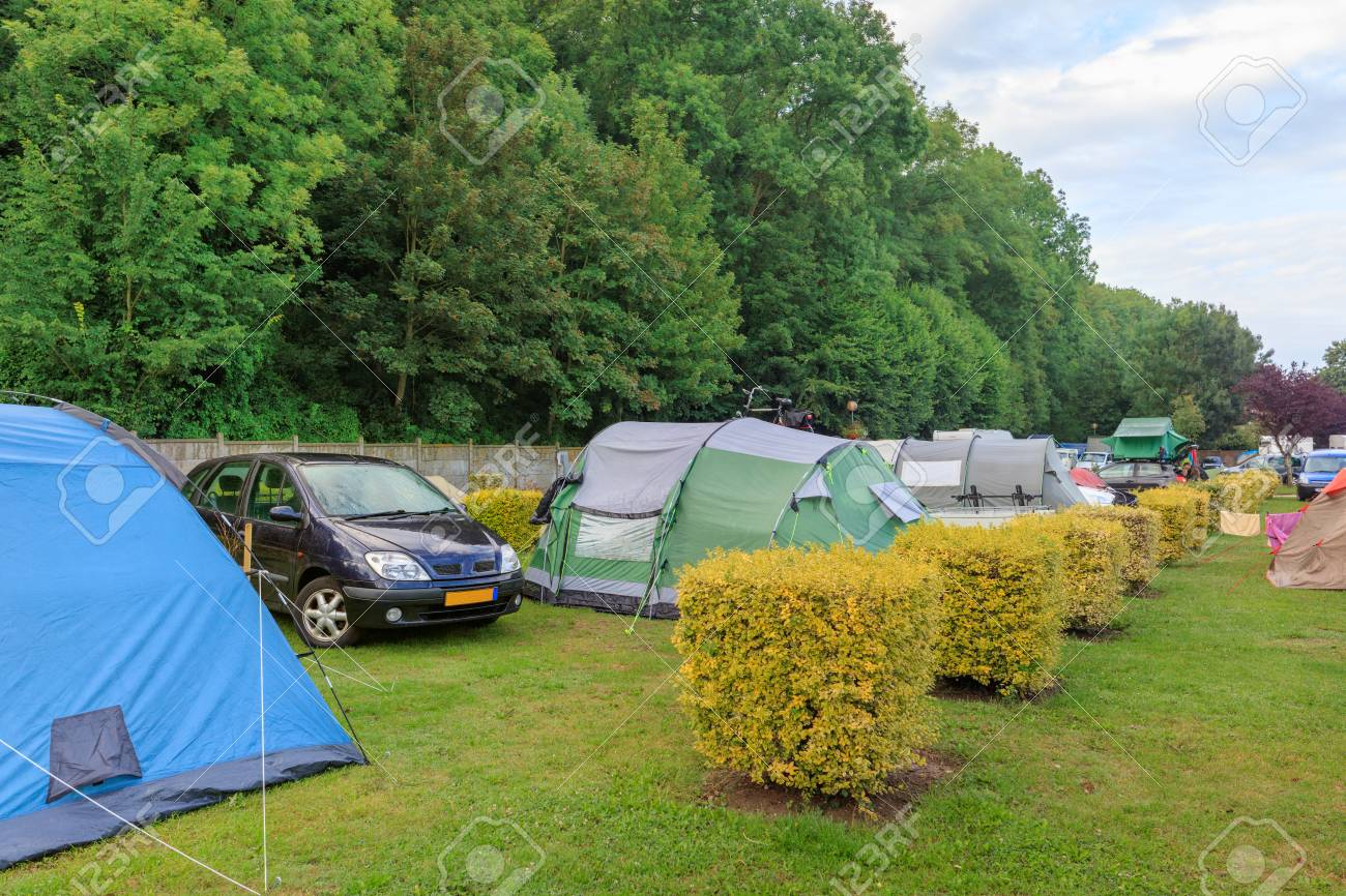 Green c&ing loan in Europe with vehicles and tents Stock Photo - 66533895 & Green Camping Loan In Europe With Vehicles And Tents Stock Photo ...