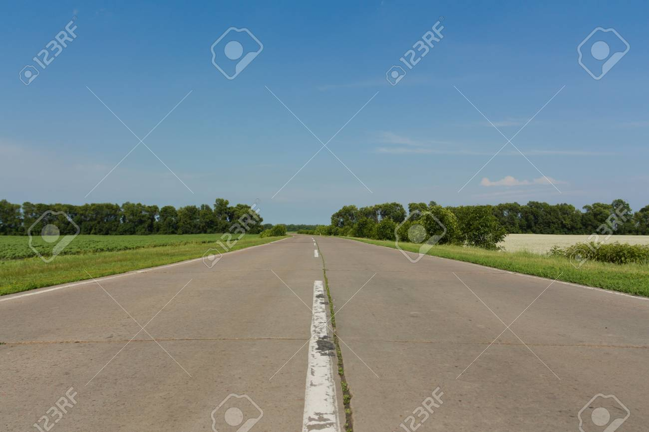 The asphalt road disappearing into the horizon Stock Photo - 14296084
