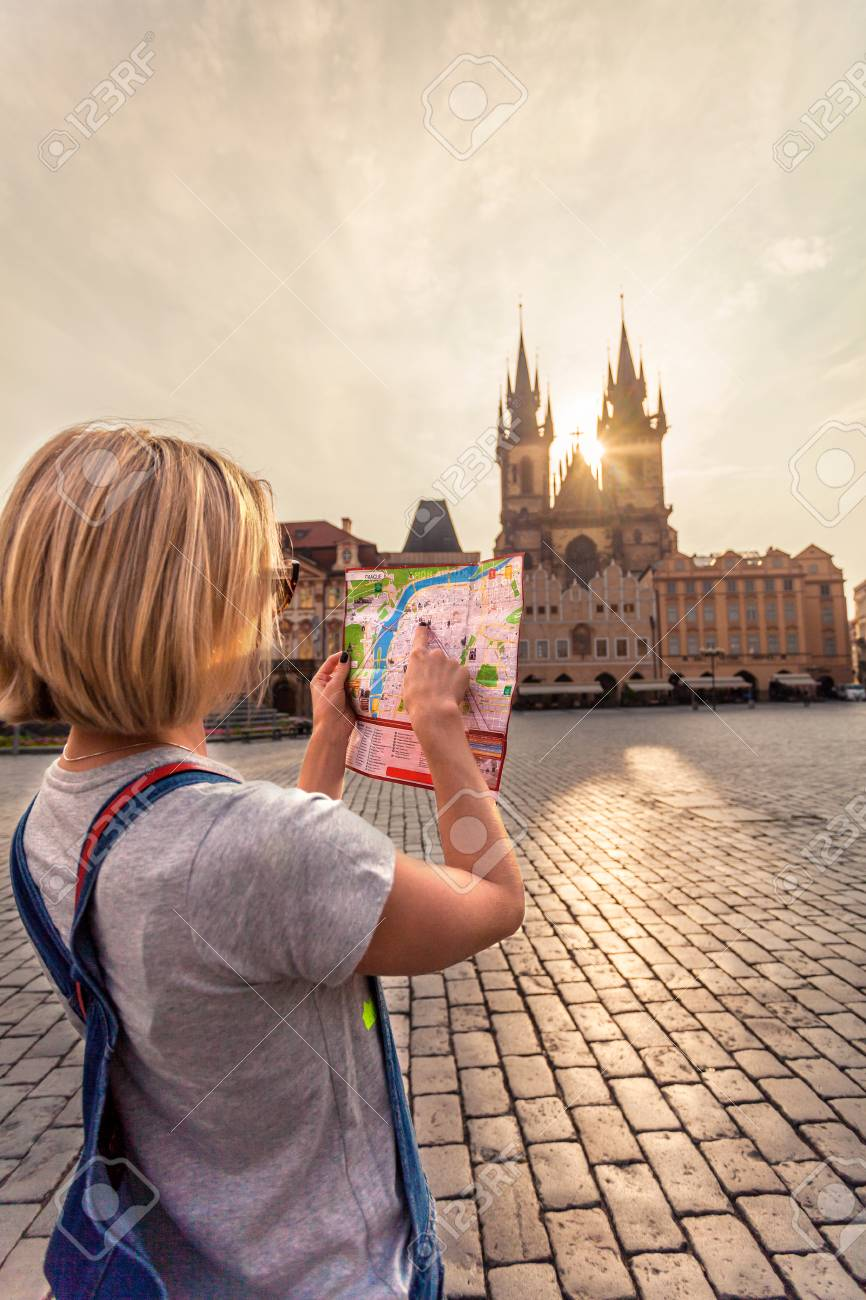 PRAGUE, CZECH REPUBLIC - JUNE 05, 2016: Woman looks at map in.. on old town krakow poland map, old town san diego map, old town dubrovnik croatia map, finland helsinki map tourist,