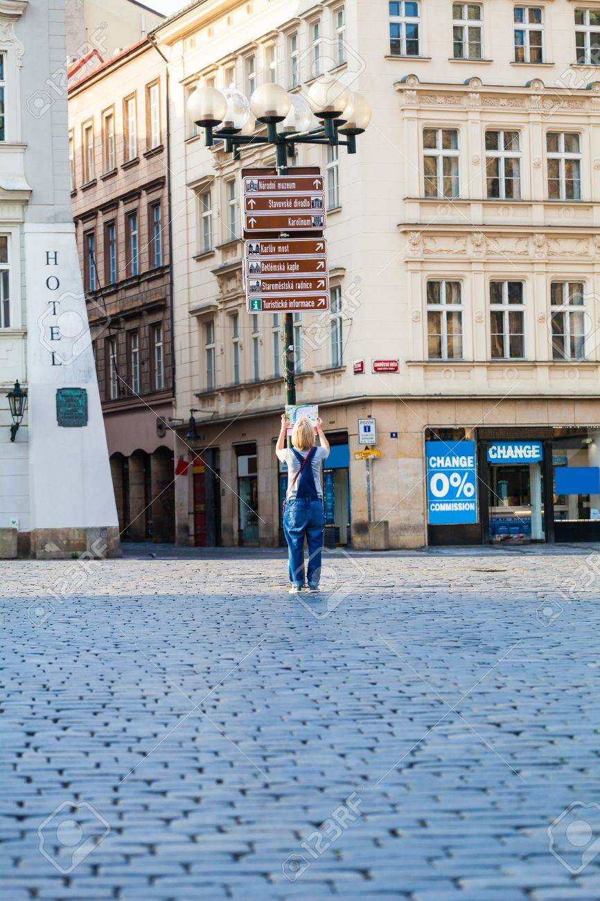Woman Looks At Map In The Old Town Square. Travel Guide, Tourism ...