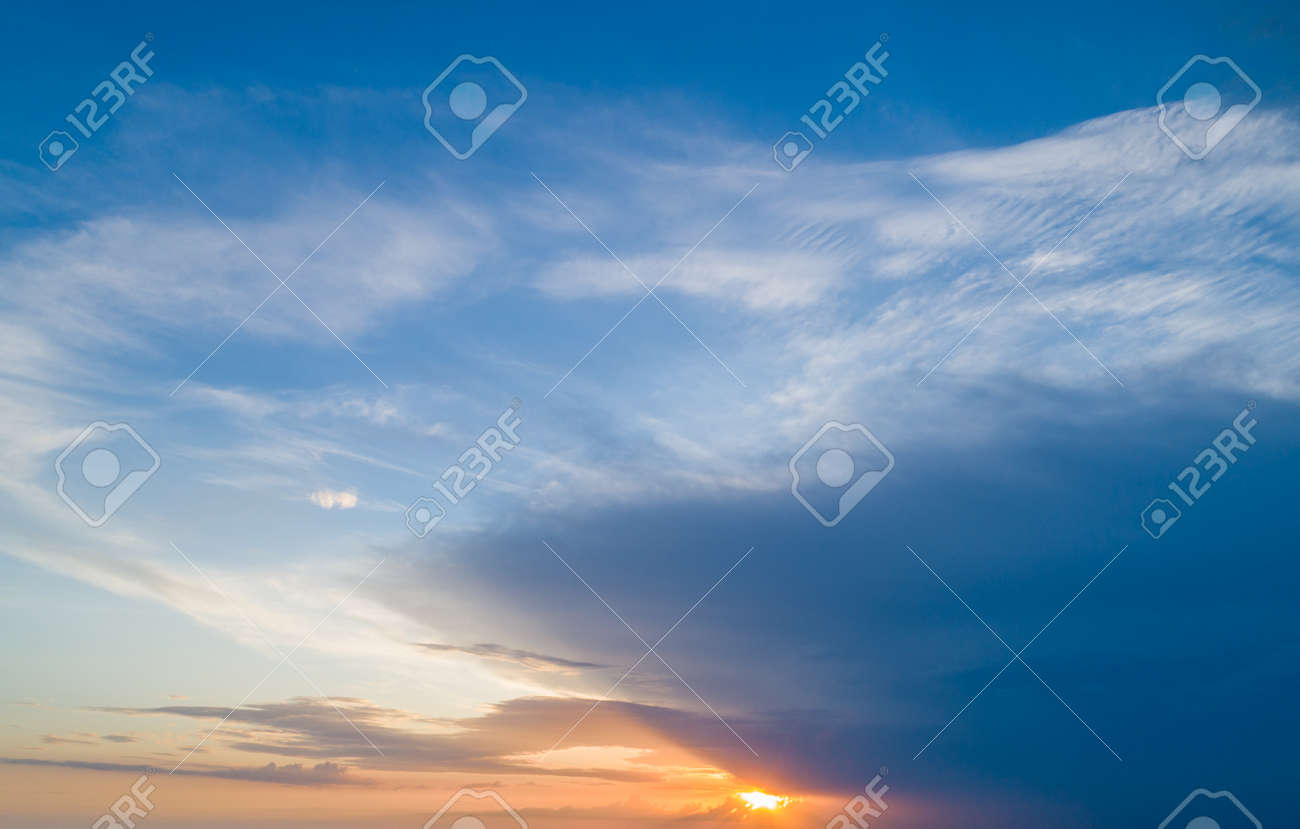 Beautiful sky with sunset sun and beautiful clouds - 150397386
