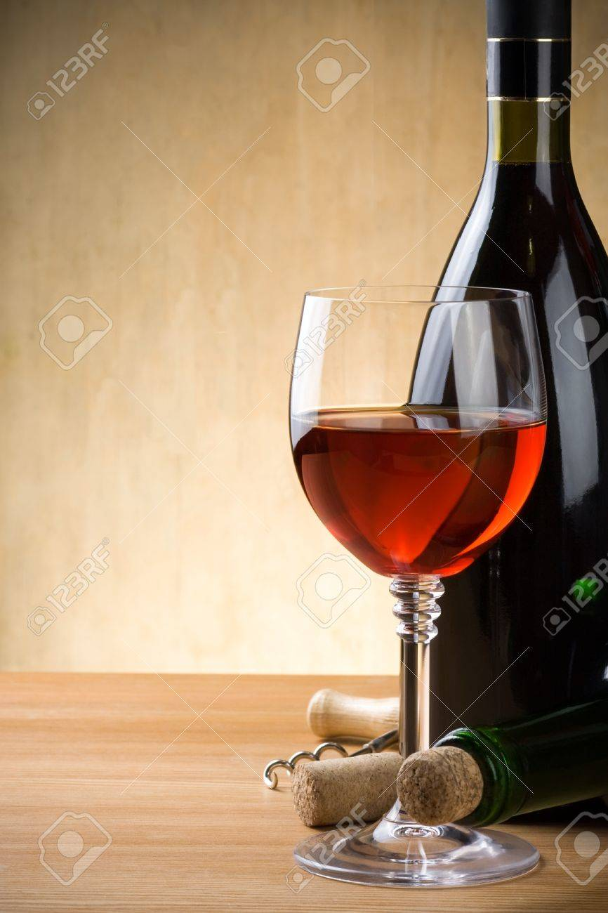 glass and bottle of wine on wood background Stock Photo - 11445999