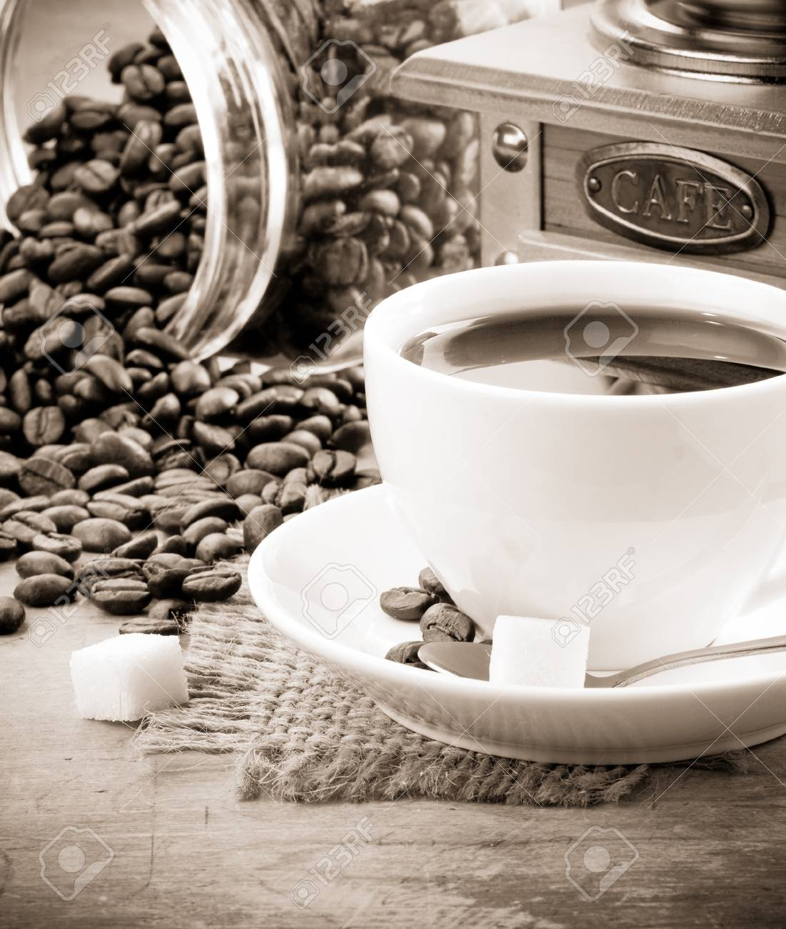 cup of coffee and grinder with roasted beans Stock Photo - 11852445