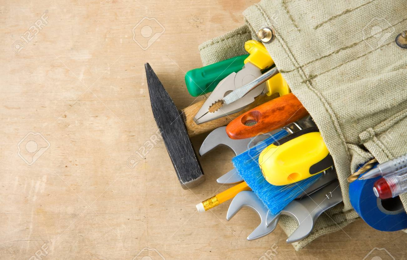 tools construction and bag on wood texture Stock Photo - 11880183