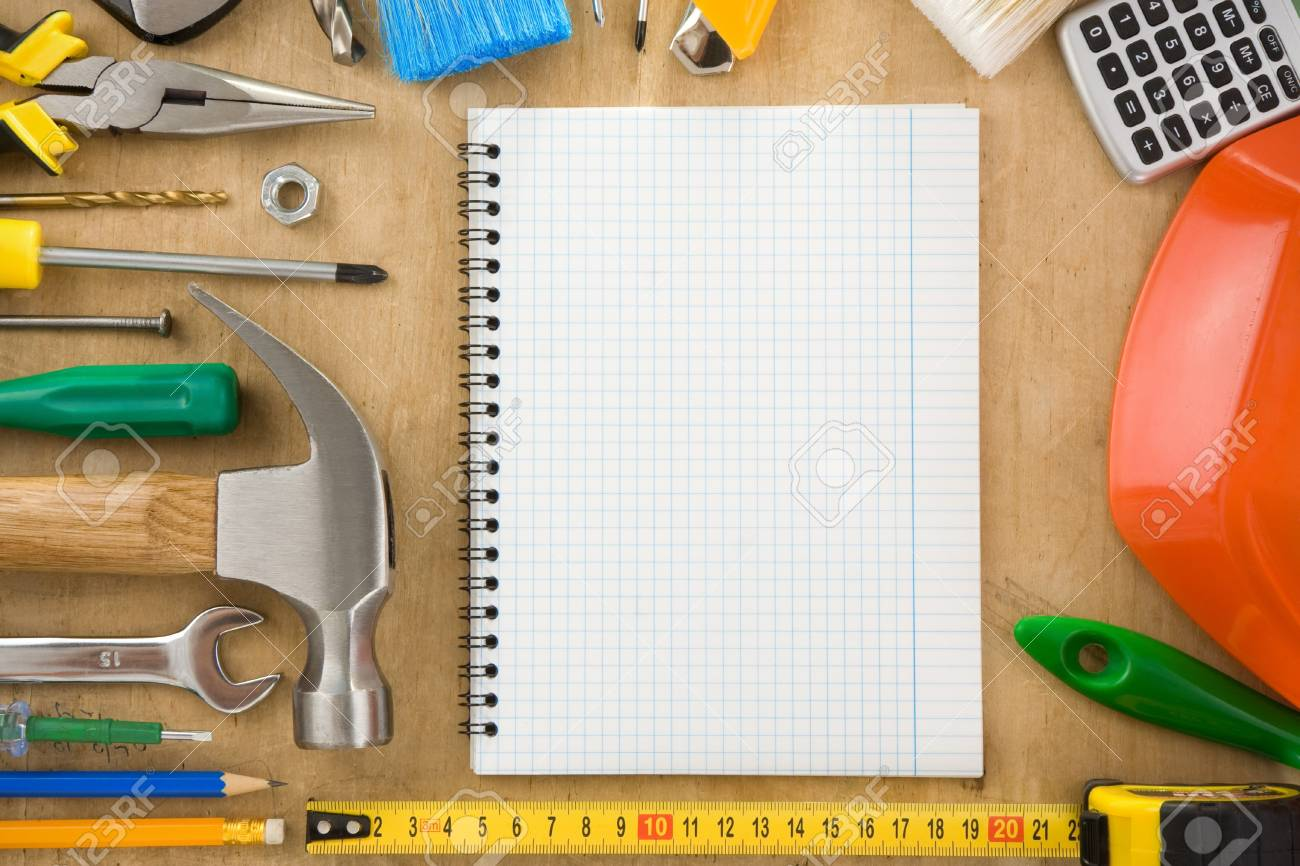 construction tools and notebook on wood texture Stock Photo - 11927265