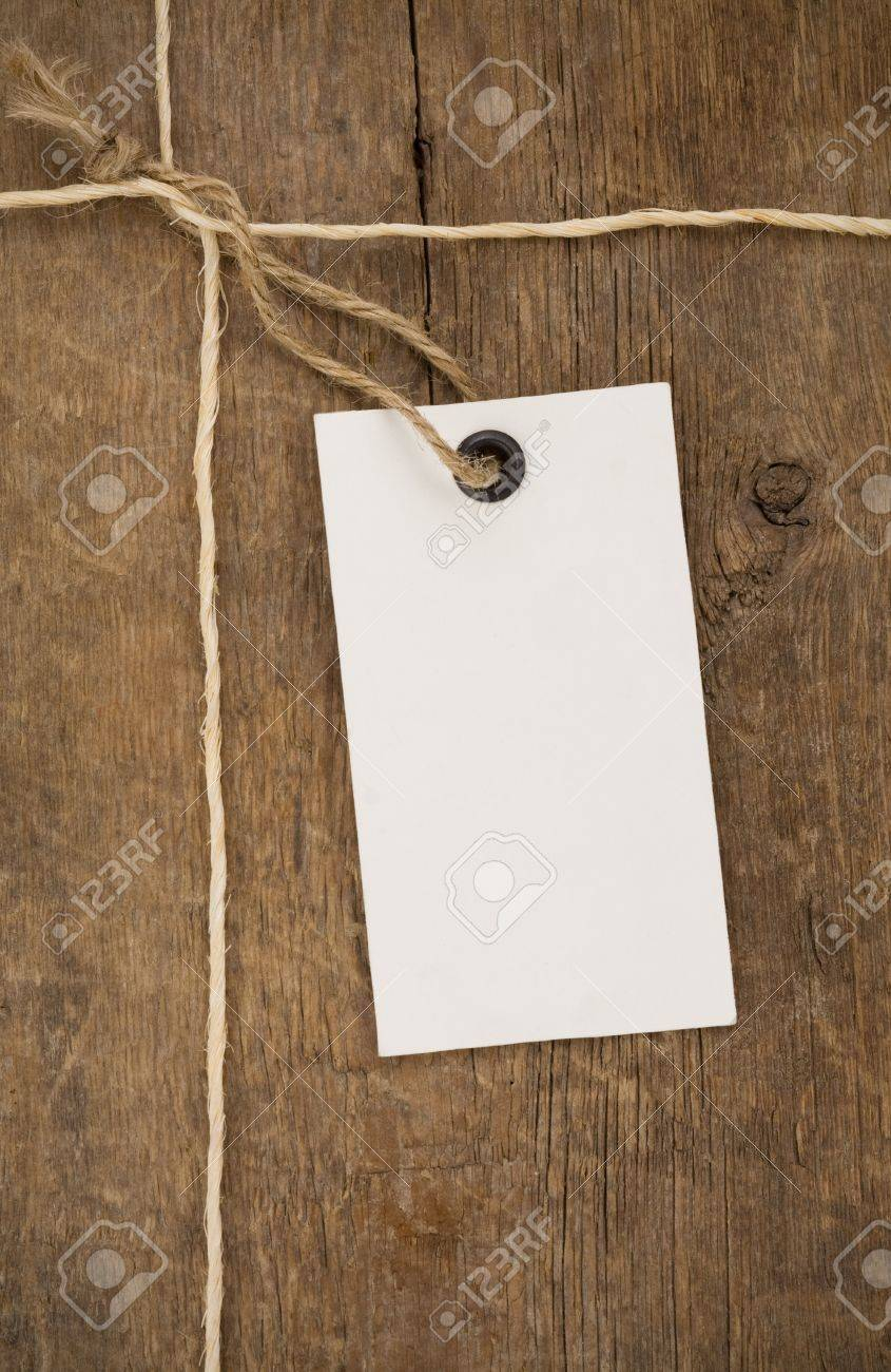 price tag on wood background texture Stock Photo - 12311481