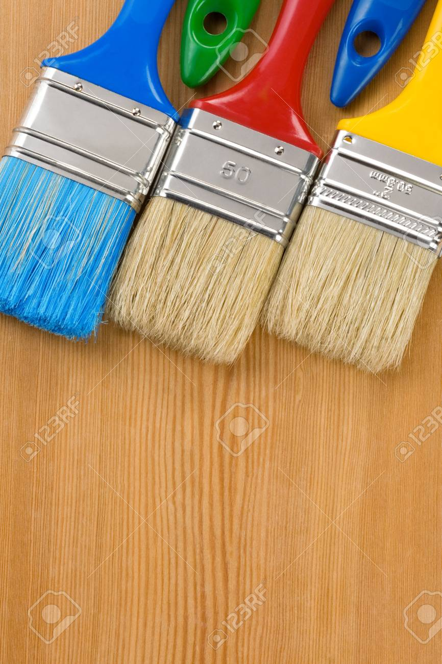colorful paintbrush on wood background texture Stock Photo - 12311331