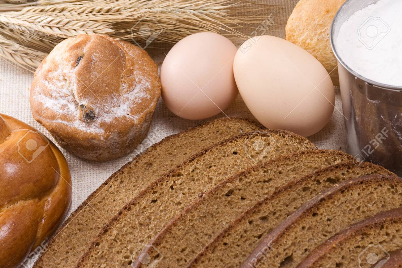 bakery products and pot on sacking Stock Photo - 13779220