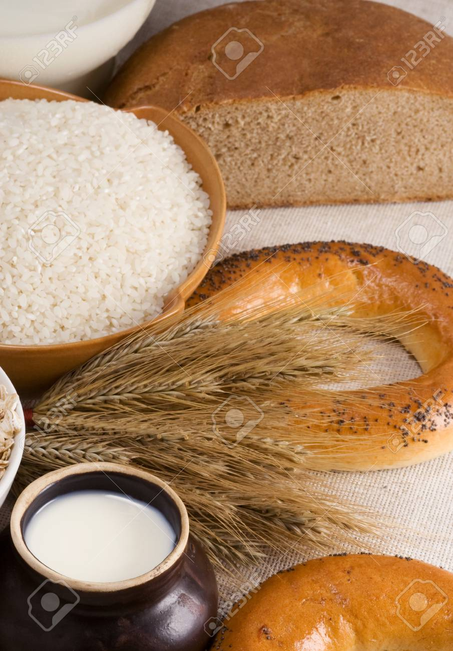 bread, rice, milk and spike on sacking Stock Photo - 13779280