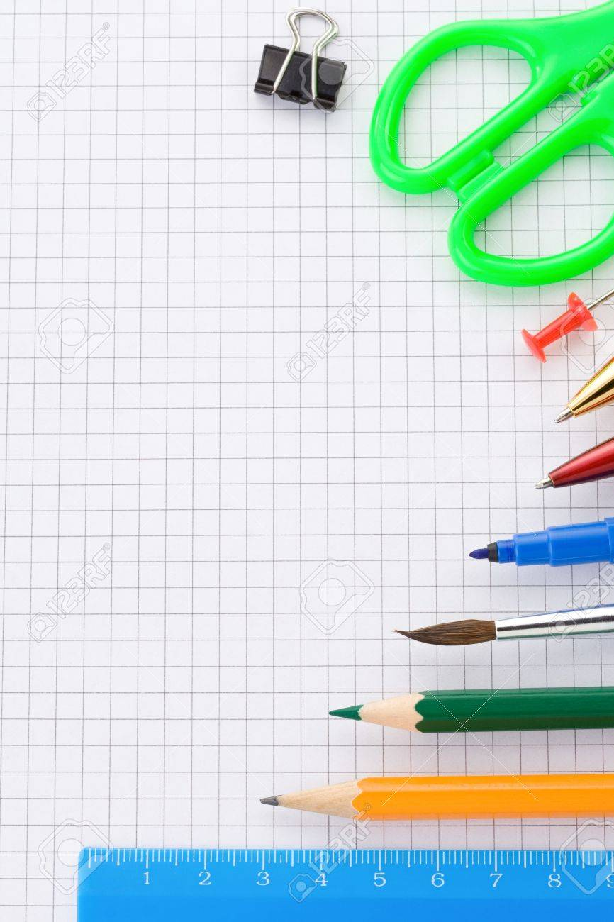 school supplies on checked paper notepad background Stock Photo - 15087167