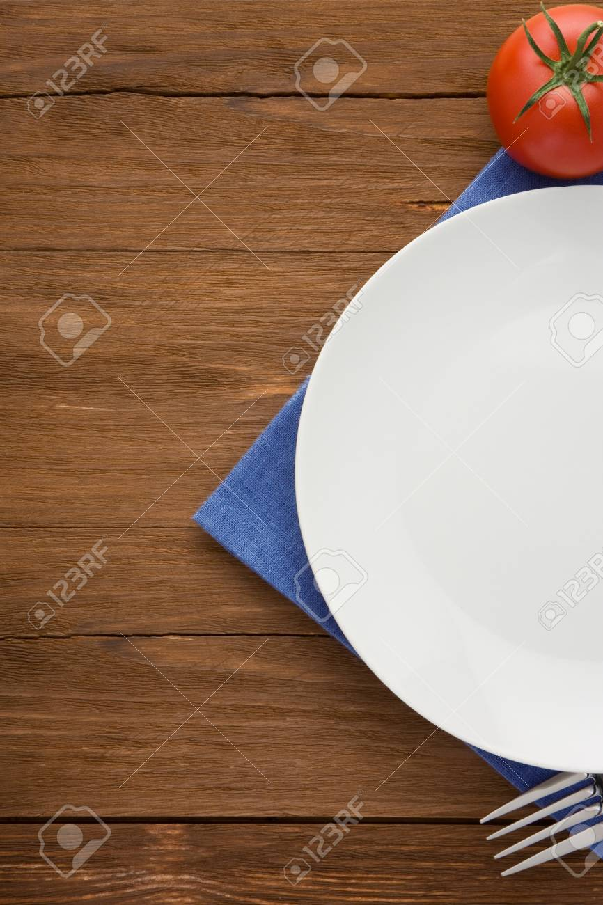 plate, knife and fork at napkin on wooden background Stock Photo - 16302073