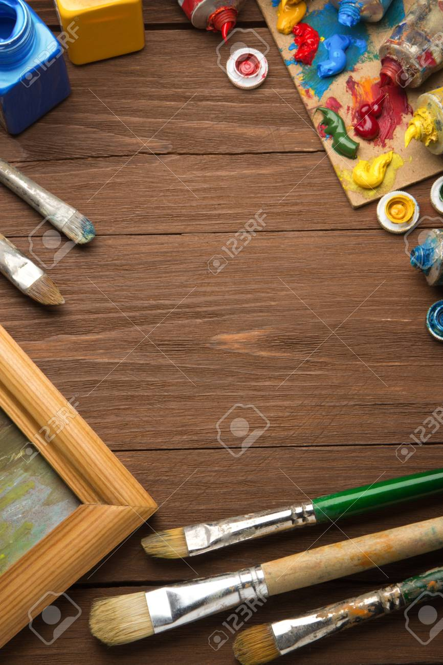 brush and painting  on wood background Stock Photo - 17283055