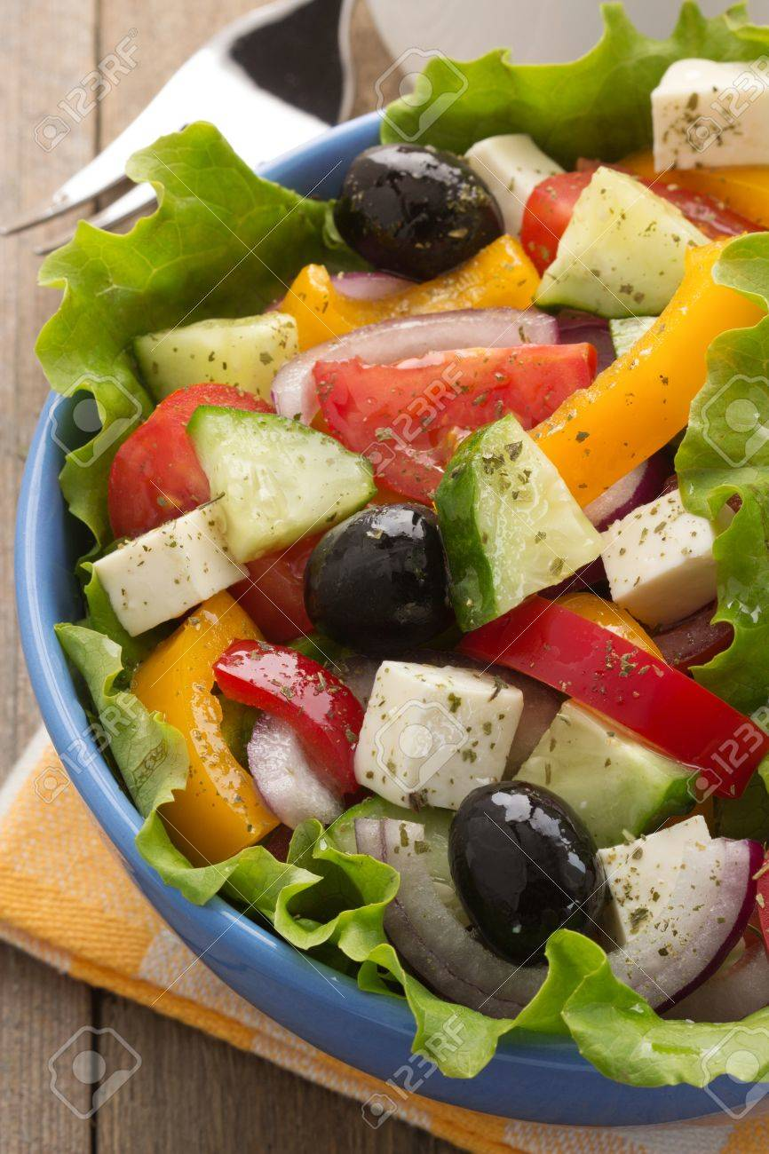greek salad on wood background Stock Photo - 20622249