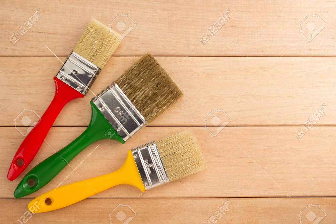 paint brush on wooden background - 38427261