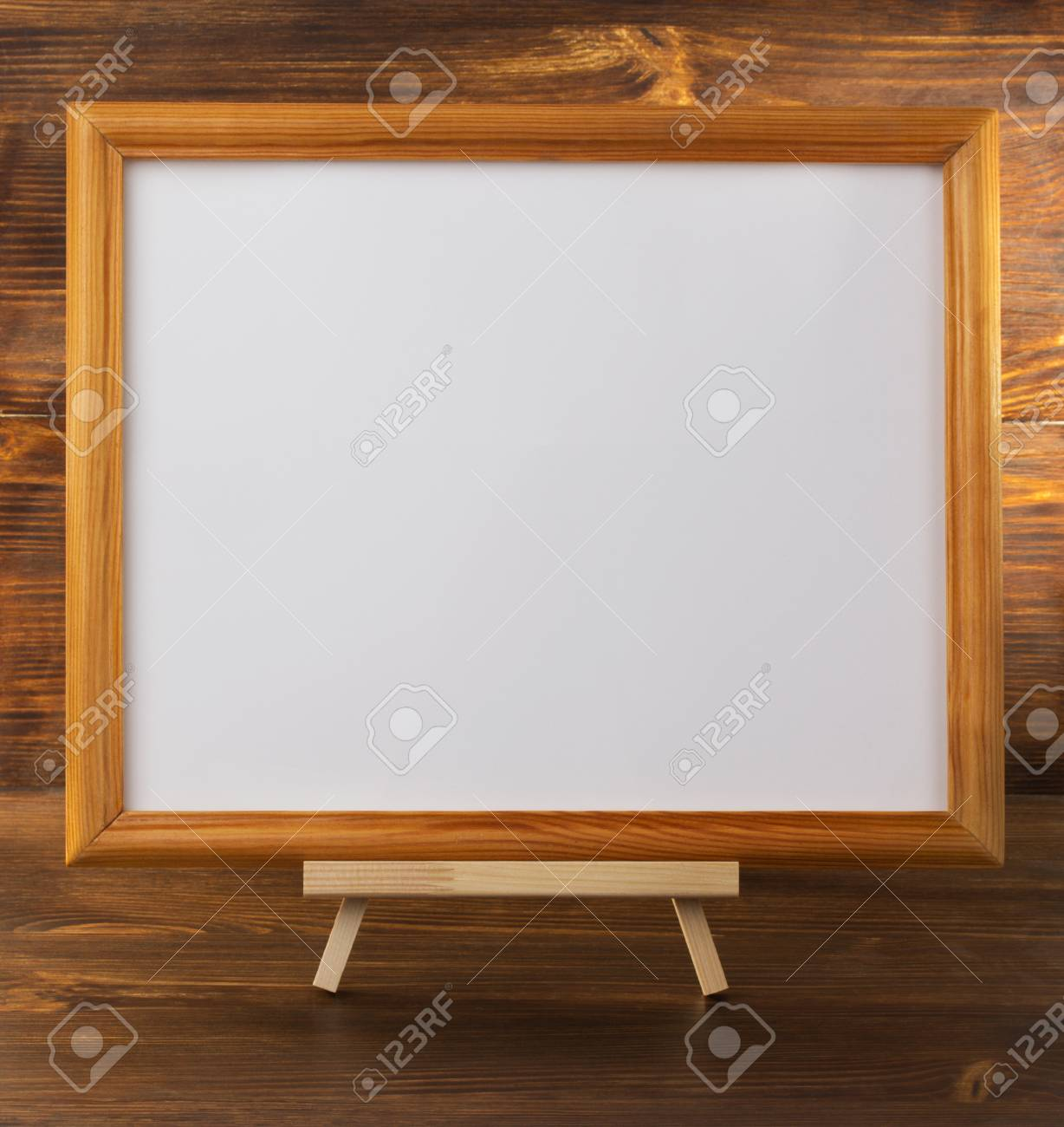 Paint Frame On Wooden Background Stock Photo, Picture And Royalty ...