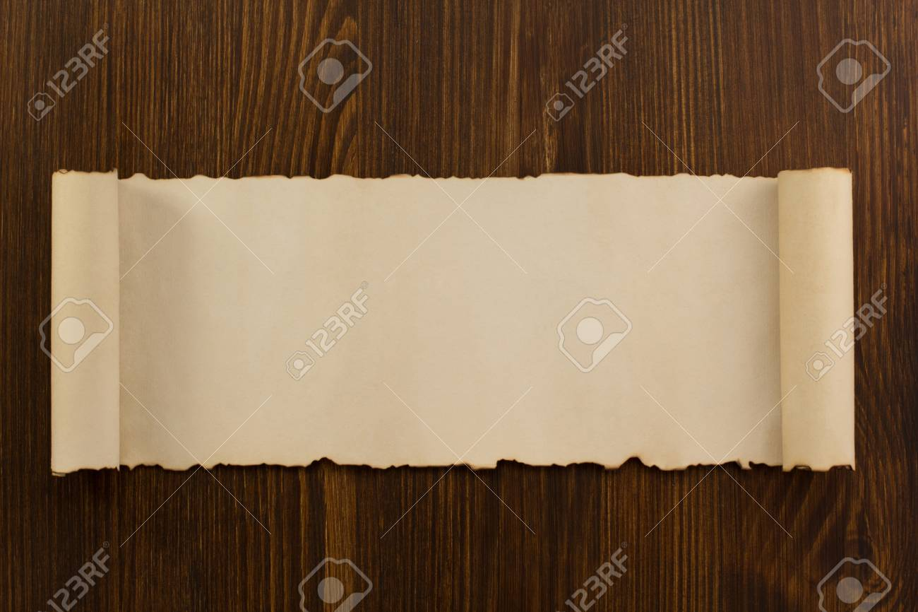 parchment scroll on wooden background - 39564884
