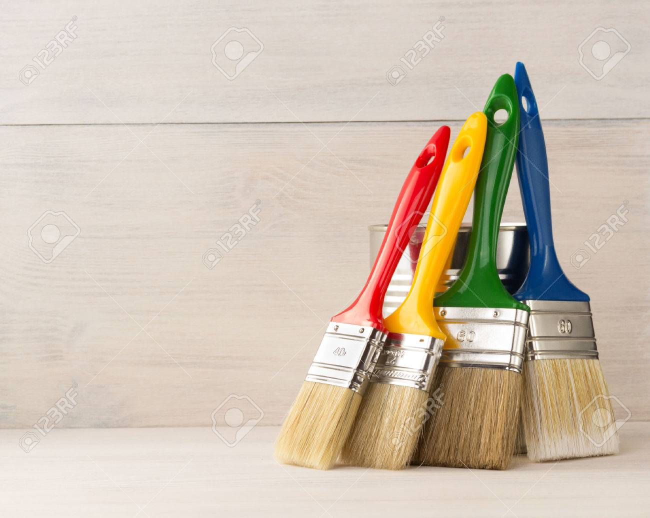 paint brush on wooden background - 39564904