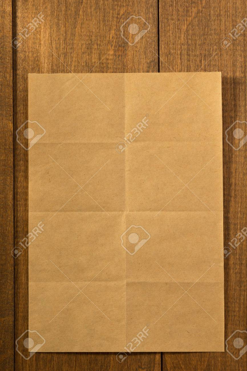 folded note paper on wooden background stock photo picture and