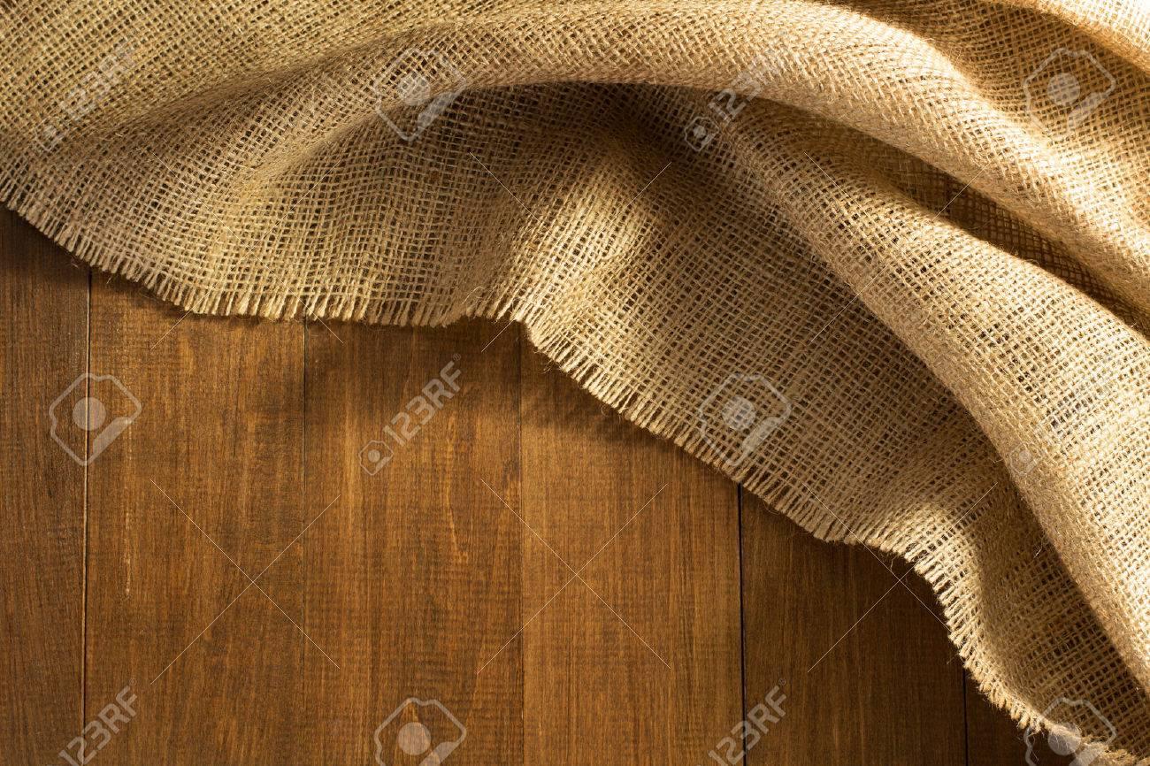 burlap hessian sacking on wooden background - 45820960