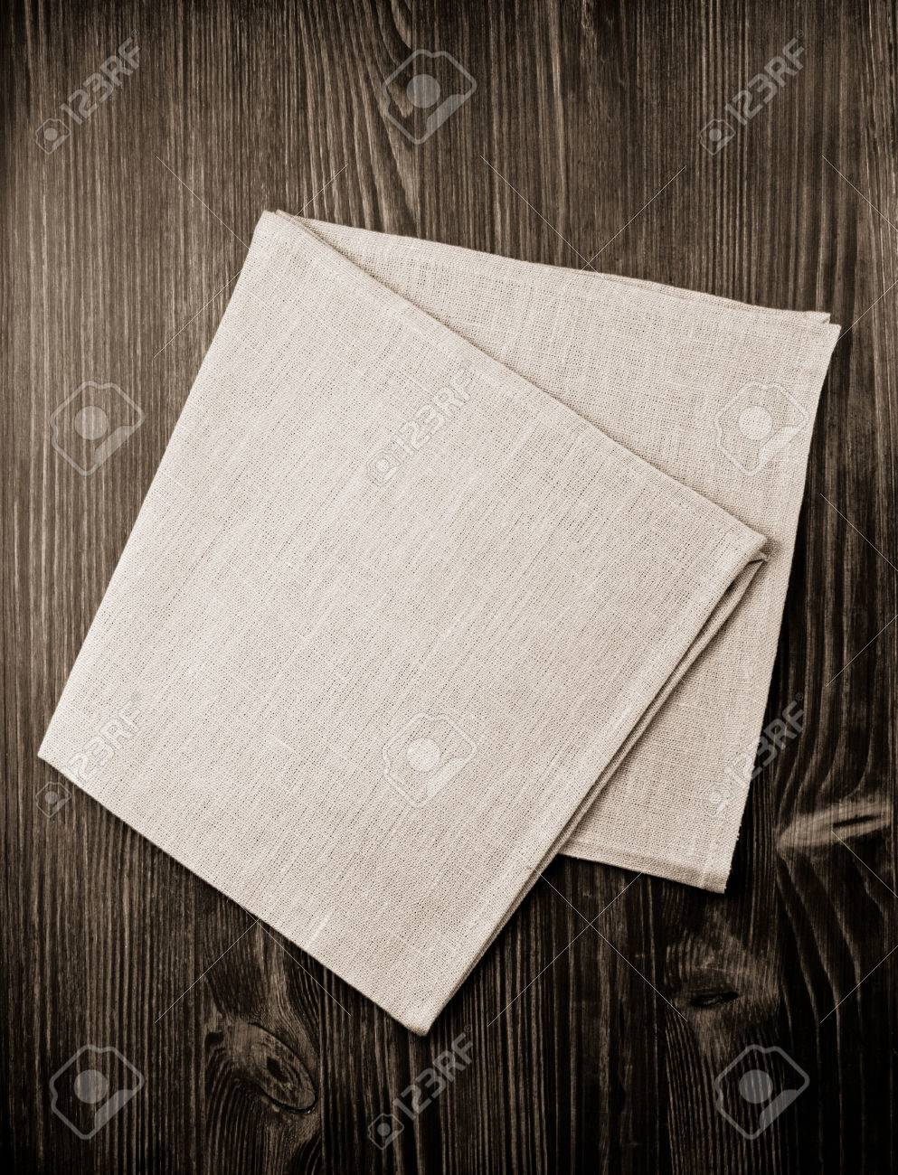 cloth napkin on wooden background - 47290207