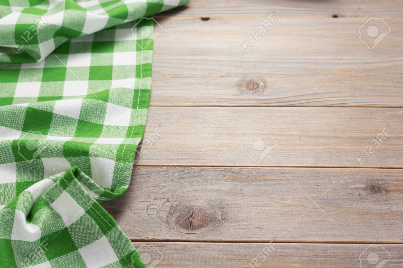 cloth napkin at rustic table in front,wooden plank board background - 128511384