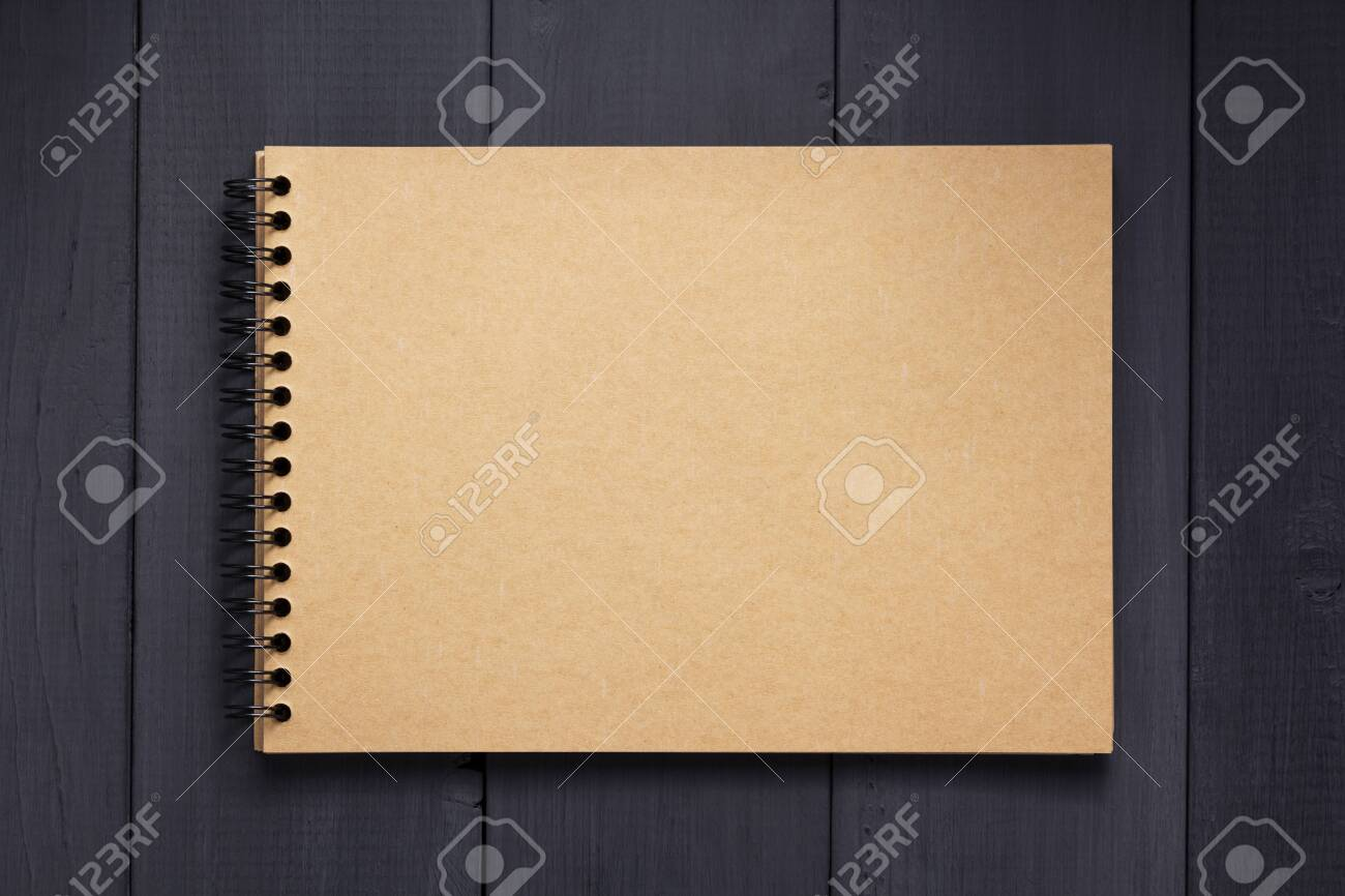 paper notebook at black wooden background surface table, top view - 135123758