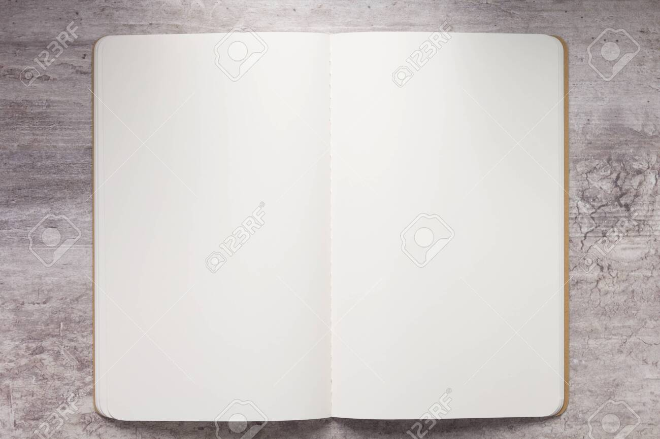 Notebook paper at stone surface table, top view - 136519114