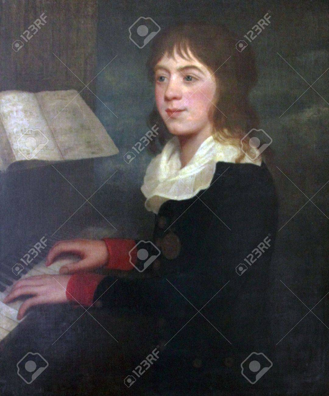 William Crotch, famous musician, composer, organist and artist. First Principal of the Royal Academy of Music, London, England is shown playing the piano when he was about 12 years old in this oil painting. He is wearing a black coat with red cuffs, gold Stock Photo - 7610421