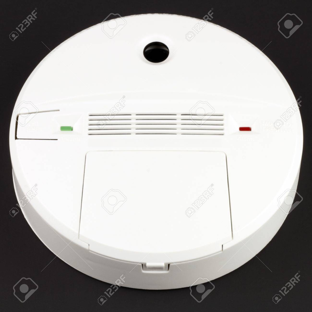 Battery powered alarm device to warn against dangerous CO buildup in indoor environments on black background. Stock Photo - 9087481
