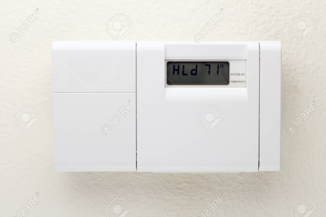 Outside of a white heating, ventilating, and air conditioning control panel on a wall. Stock Photo - 9087483